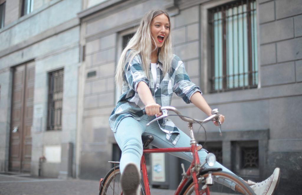 photo-of-woman-riding-bicycle